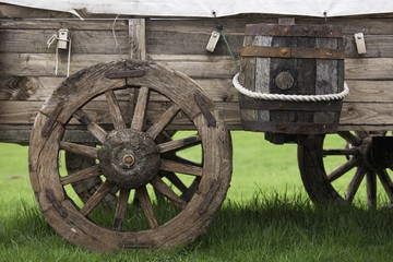 Northumberland, England; An Old Wooden Carriage With A Barrel Strapped To The Side