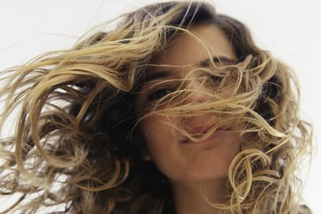 Young Woman With Long Hair Blowing In The Wind; Tarifa, Cadiz, Andalusia, Spain