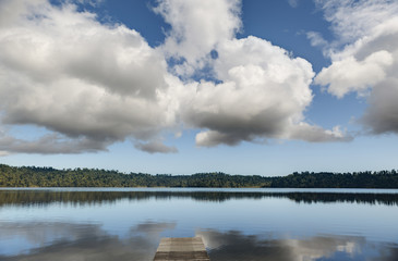 Clouds reflected into Lake Ianthe; South Island, New Zealand