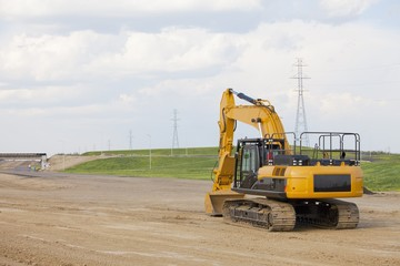 Road Construction Using A Backhoe; Edmonton, Alberta, Canada