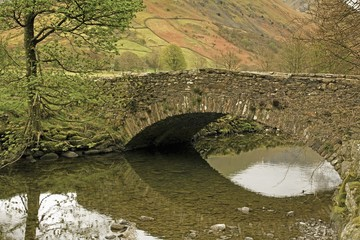 Cumbria, England; A Cow Bridge Over Brothers Water In Lake District National Park