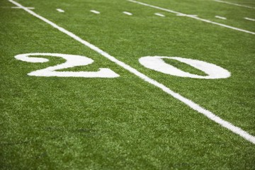 The 20 yard line marked on a football field