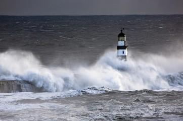 Seaham, Teesside, England; Waves Crashing On Lighthouse