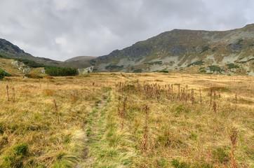 Beautiful mountain landscape. Mountain trail in the autumn scenery in High Tatra, Slovakia.