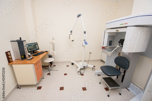 Dentistry Office. Cabinet With Modern Orthopantomograph, Dental Panoramic  X Ray Machine To Produce