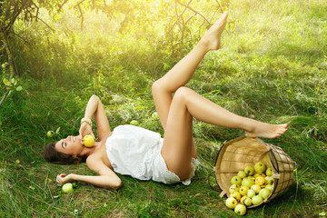 Happy woman in garden during a picking apples