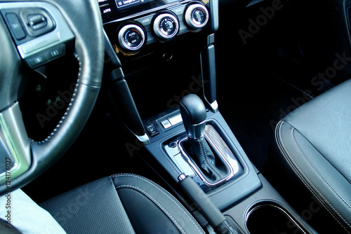 Top view of automatic gear shift knob inside the vehicle interior