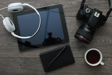 Office desk with Technology Equipment tablet, Camera and earphone
