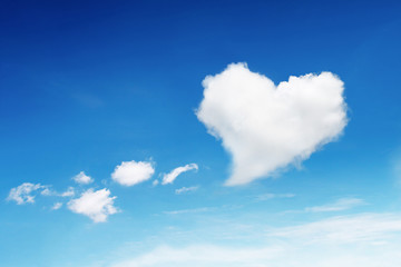 one heart shaped cloud on blue sky