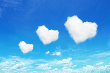 three heart shaped clouds on blue sky