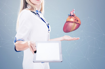 Double Exposure Doctor holding human organs ( heart) and tablet , gray background.