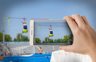Woman photographs to a smartphone