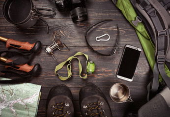 Hiking accessories. Boots, backpack, sunglasses, photo camera, map