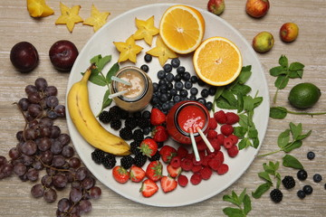 Fruit smoothies with blackberryt, strawberry, mint, orange and banana on white background