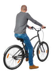 back view of a man with a bicycle. cyclist sits on the bike. Rear view people collection.  backside view of person. Isolated over white background.