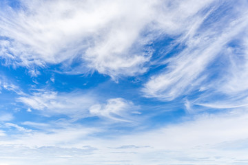Texture and layer of white fluffy clouds spread on blue sky back