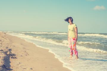 Joyful woman enjoying life on beach