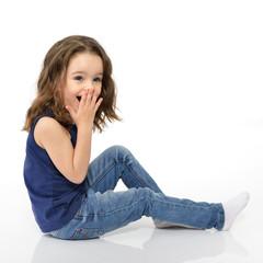 Sweet little girl, studio portrait over white background