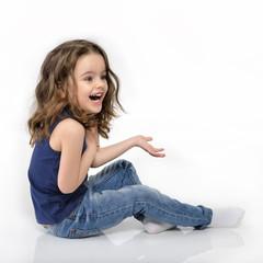 Sweet little happy emotional surprised girl, studio portrait ove