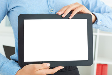 Woman shows blank screen of digital tablet in her hands.