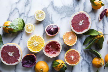 Citrus fruits. Grapefruits, lemons, and oranges on marble backgr