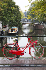 Red bike on a bridge in Amsterdam