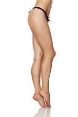 beautifully cared feminine legs and black panties