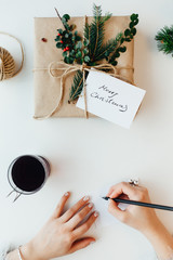 Woman writing Greeting Card for presents