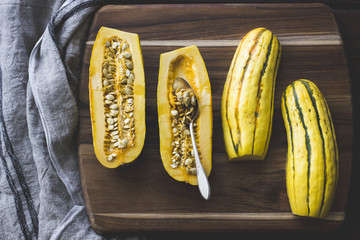 Delicata squash on wood board.