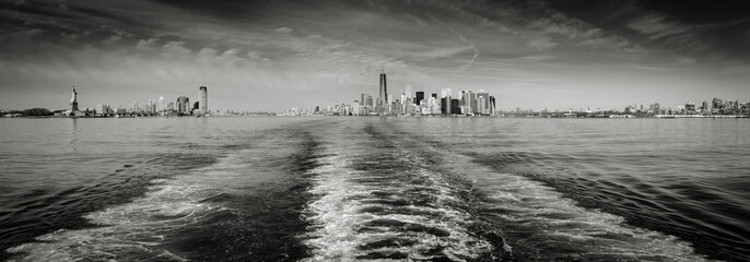 Wall Mural - New York cityscape encompassing Lower Manhattan with Battery Park and the Financial District skyscrapers, downtown Jersey City and Brooklyn. Black & White panoramic. New York City