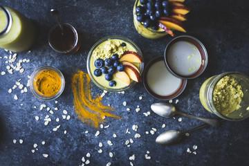 Healthy Golden milk overnight oats for breakfast with fresh frui