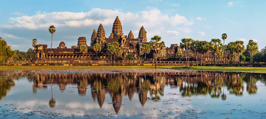 Ingelijste posters Bedehuis Ancient Khmer architecture. Panorama view of Angkor Wat temple at sunset. Siem Reap, Cambodia