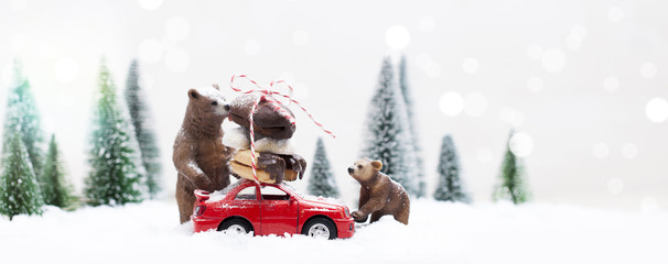 Snowy Winter Forest with a grizzly bear and a miniature red car