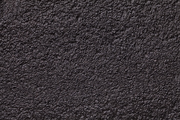 Black glossy background foam closeup. Texture of the rubber construction material
