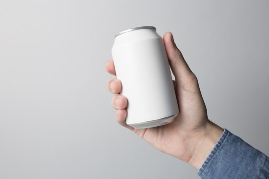 Blank Can in hand on white background, ready to replace your design