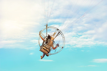 rear view paraglider fly with paramotor flying in the air on  blue  sky  background