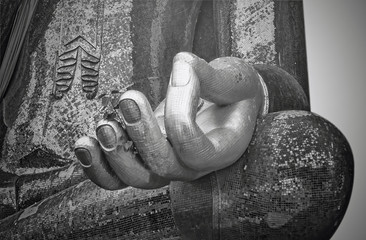 Buddha statue in Wat Si Chumi thailand, black and white focus at hand