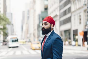 Businessman in street, Manhattan, New York, USA