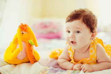 .beautiful little girl playing with toy