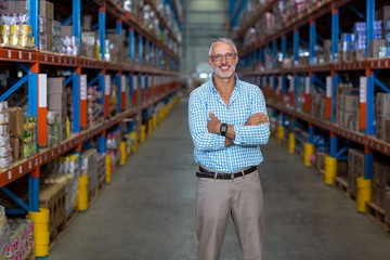 Warehouse manager standing with arms crossed
