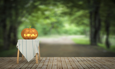 Halloween pumpkin on wooden floor in the house and nature forest
