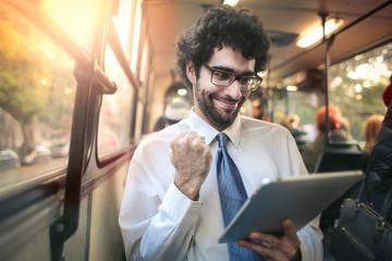 Successful businessman on a tram