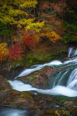 Vertical shot of long exposure Ryuzu waterfall in autumn Nikko Touchigi Japan