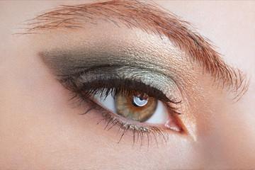 Woman with green eye smokey make up