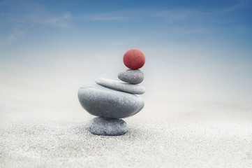 Photo sur Plexiglas Zen pierres a sable Balancing colorful zen stones pyramid on sandy beach under blue sky. Beautiful nature and spiritual concept