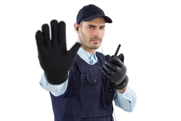 Confident security officer making stop gesture