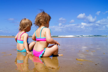Two little girls on the beach.
