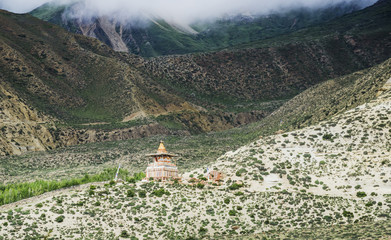 A distant chorten on a mountain slope along the route from ghemi to lo manthang;Upper mustang nepal