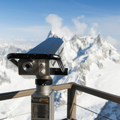 Binoculars with a view of the snow covered french alps;Chamonix-mont-blanc rhone-alpes france