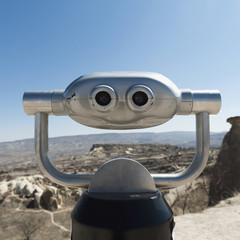 Binoculars with a view of the landscape and a blue sky;Urgup nevsehir turkey